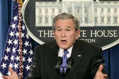 http://joshandjosh.typepad.com/josh_josh_are_rich_and_fa/images/2008/03/19/george_w_bush_idiot.jpg